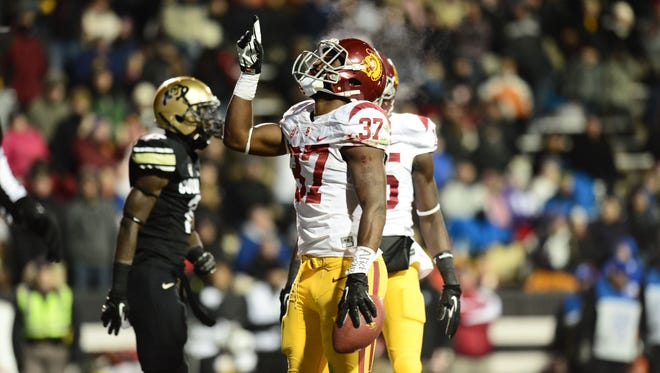 Southern California Trojans running back Javorius Allen (37) reacts to his touchdown in the second quarter against the Colorado Buffaloes  at Folsom Field.