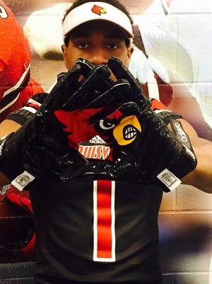 Desmond Fitzpatrick shows off some U of L gloves.