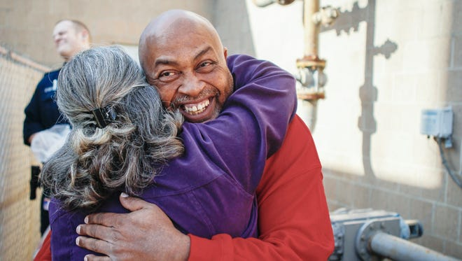 William 'Ricky' Virgil hugs members of the Kentucky Innocence project after stepping outside of the Campbell County jail. After spending more than 28 years in prison for a murder he claims he never committed, Virgil got his first hint of freedom Christmas Eve morning.