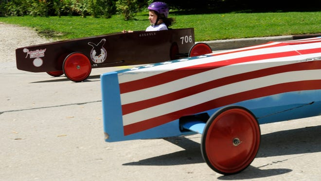 In this HTR Media file photo, Makayla Pues races in the annual Gravity Hill Derby race down the hill on Conroe Street in Manitowoc.