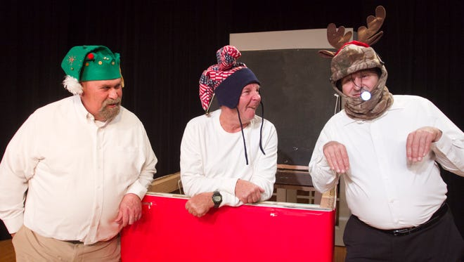 """From left, Kevin Whitehead as """"Hermie the Dentist Elf,"""" Dennis Hubel as """"Charlie in the Box"""" and Bill Brezina as """"Gustav the Green-nosed Reingoat"""" prepare for the Hartland Players Main Stage performance of """"Every Christmas Story Ever Told (And Then Some!)."""""""