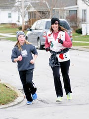 Gibsonburg's second annual Ugly Christmas Sweater Run brought out some smiling, spirited runners Saturday morning.