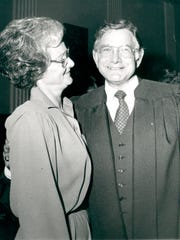 G. Ross Anderson hugs his wife, Dot, shortly after wearing the robes of a federal judge for the first time in 1980.