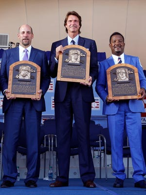 Craig Biggio, John Smoltz, Randy Johnson and Pedro Martinez hold their plaques after an induction ceremony at the Clark Sports Center on Sunday, July 26, 2015, in Cooperstown, N.Y.