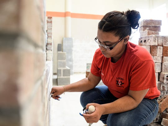 Keichsla Morales, 18, a senior at Lebanon High School works on her project in the masonry classroom at the Lebanon County Career and Technology Center on Thursday, January 14, 2016.