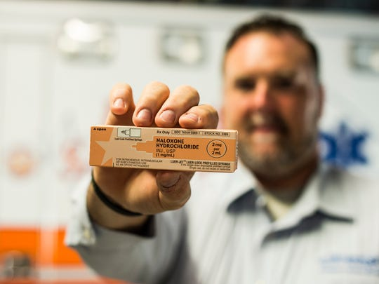 Bryan Smith, director of First Aid and Safety Patrol, holds a box of naloxone, the opioid overdose antidote, on Tuesday, June 7, 2016.