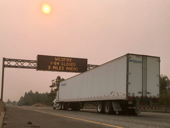 A sign warns of a highway closure on Interstate 84