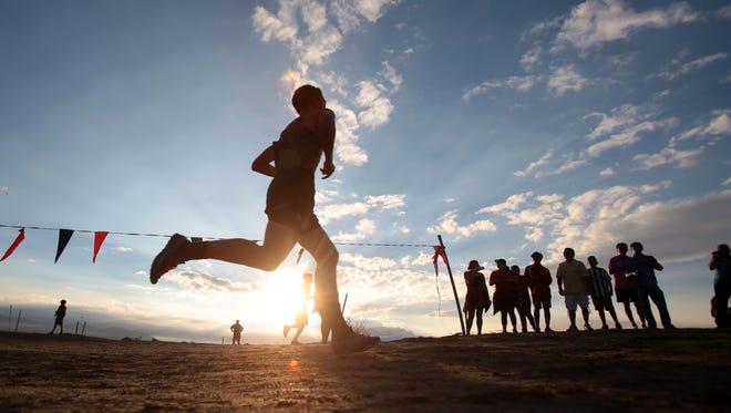 FILE - The boys varsity race during the cross country meet at Xavier College Prep in Palm Desert on Wednesday, September 21, 2016.