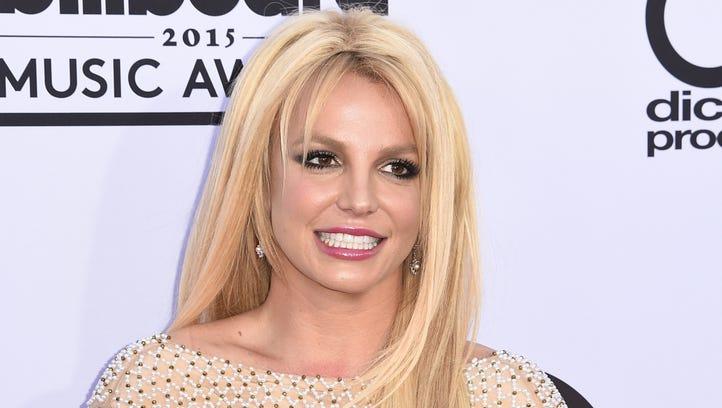 Britney apparently got an orangey-golden ticket to Willy Wonka's factory.