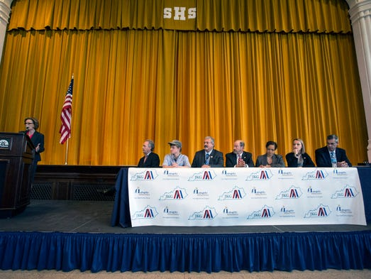 A panel of speakers gathered in the auditorium at The