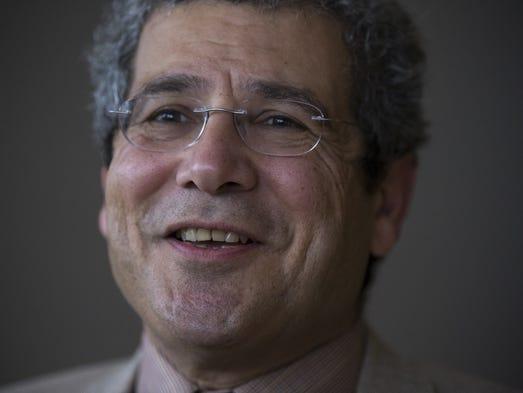 A portrait of Dr. Edward Zamrini, a neurologist and