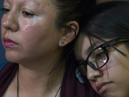 Guadalupe Garcia de Rayos (left) and her daughter,