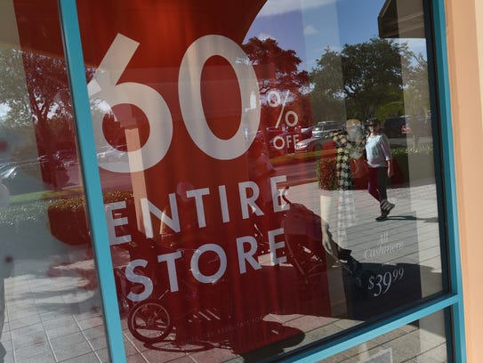 Sales banners hang on Black Friday in 2015 on the Treasure