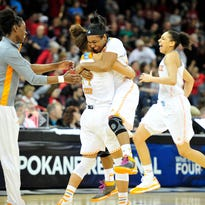 Tennessee guard Andraya Carter, left, hugs guard Ariel Massengale, right, in celebration after defeating Gonzaga 73-69 in OT during the Sweet 16 game at Spokane Arena in Spokane, Wash., Saturday, March 28, 2015.