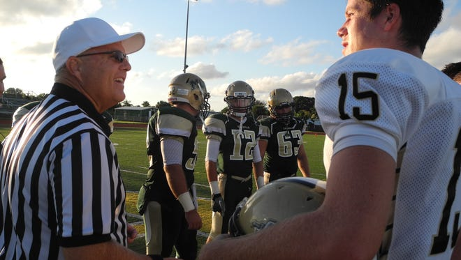 Captains from MCC and St. Pete Catholic pre-game.