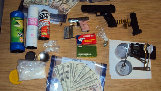 A two-month narcotics investigation has culminated in the arrest of a father and son on an array of drugs and weapons charges.