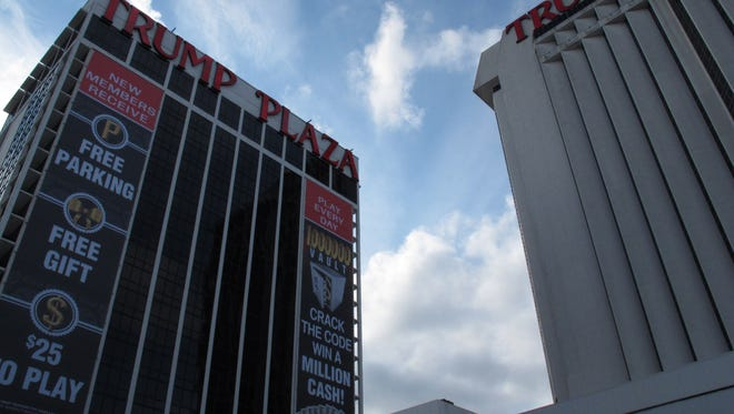 This Dec. 9, 2011 photo shows the exterior of Trump Plaza Hotel and Casino in Atlantic City N.J. The casino's parent company said on Saturday July 12, 2014 that it expects to close Trump Plaza on Sept. 16. It would be the third Atlantic City casino to shut down this year.(AP Photo/Wayne Parry) ORG XMIT: RPWP103