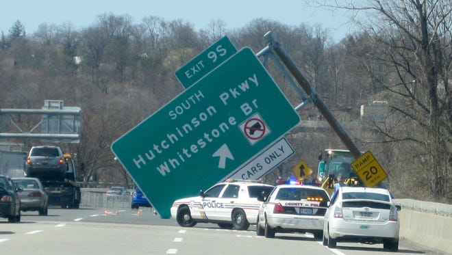 A fallen highway sign blocks two lanes of traffic on the Westbound side of Westchester Avenue on Apr. 9, 2013. ( Ricky Flores/The Journal News )