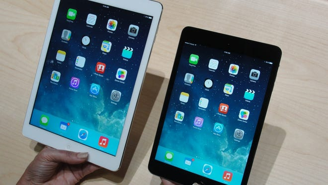 Apple's new iPad Air (left) and iPad Mini tablets are seen in October in San Francisco, as Apple unveiled upgraded versions of its iPads, with more power and sleeker designs to ramp up competition against rivals who now have a majority of the tablet market.