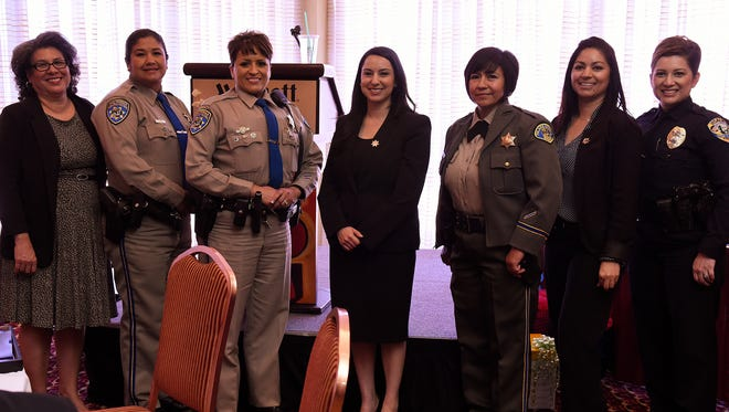 The United Women's Organization honored Latinas who enforce the law and pursue justice Thursday at the Marriott Hotel in Visalia. The honorees, from left: retired Probation Department Manager Mary Ann Berumen-Loza; CHP officers Ana Carreon and Graciela Torres Torres; Deputy District Attorney Erica Gonzalez; Tulare County Sheriff Detective Esmeralda Ramos; Criminal Investigator Beatriz Reveles; and Visalia Police Detective Celestina Sanchez.