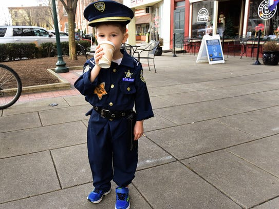 Three year-old Kelby Elmer wears his crime fighter