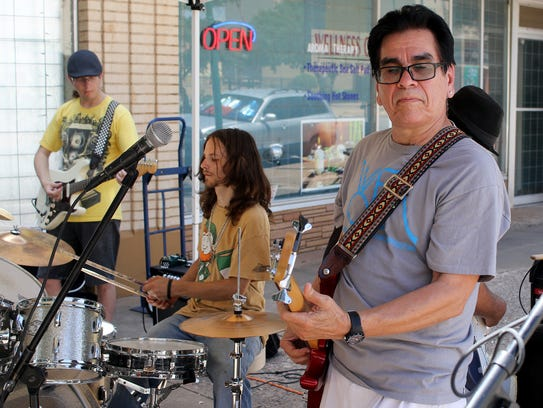 Mick Jason, right, performs Saturday, July 22, 2017,