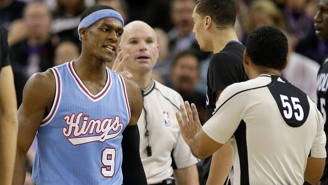 Sacramento Kings guard Rajon Rondo, left, questions official Bill Kennedy (55) about a foul call during the second half of an NBA basketball game against the Minnesota Timberwolves.