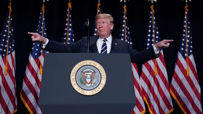 US President Donald Trump speaks at the National Prayer Breakfast at a hotel in Washington, DC on February 8, 2018.