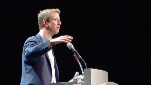 U.S. Rep. Derek Kilmer speaks Wednesday night at the Admiral Theatre in Bremerton to a town hall of about 1,000 people.