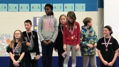Fifth-graders participate in a medal ceremony at Riverside's Math Olympics.