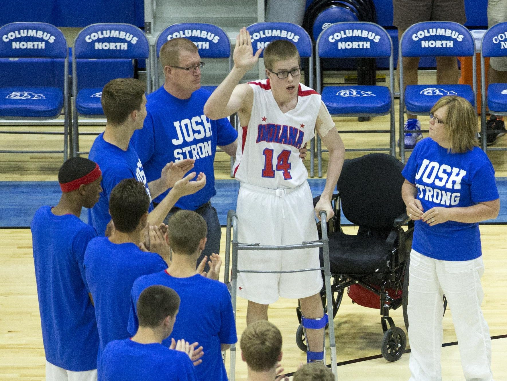 Recovering from serious injuries, Josh Speidel took a few steps in June as he was introduced before the Indiana Basketball All-Stars action against the Indiana juniors, at Columbus North High School, where Josh played.