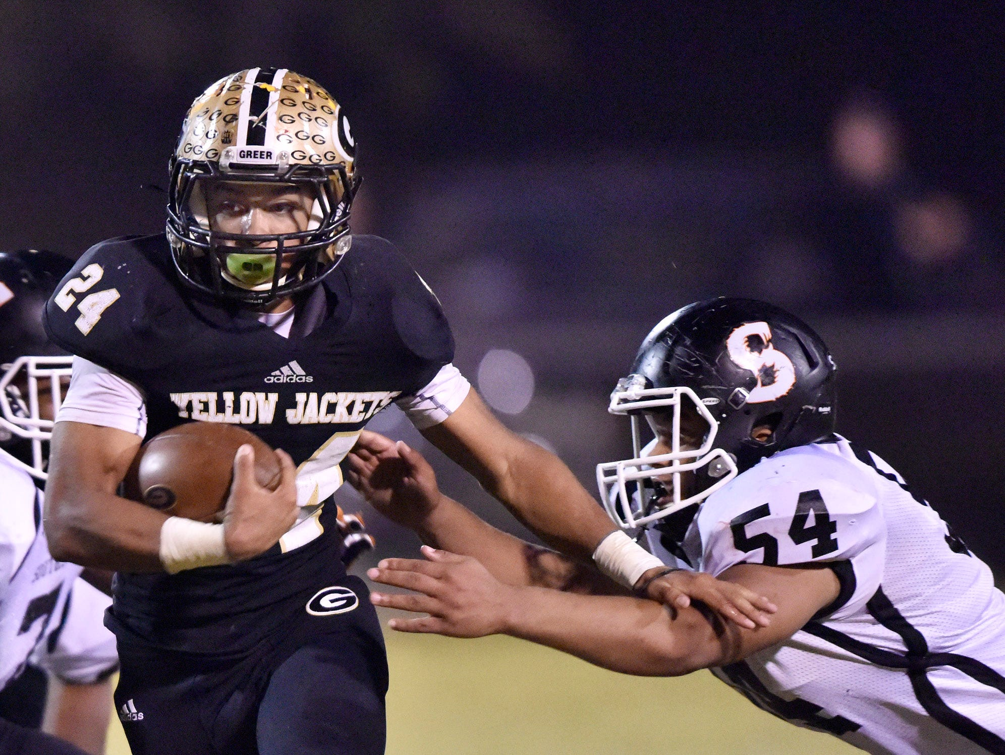 Greer's Adrian McGee (24) escapes Southside's Anthony Smith (54).
