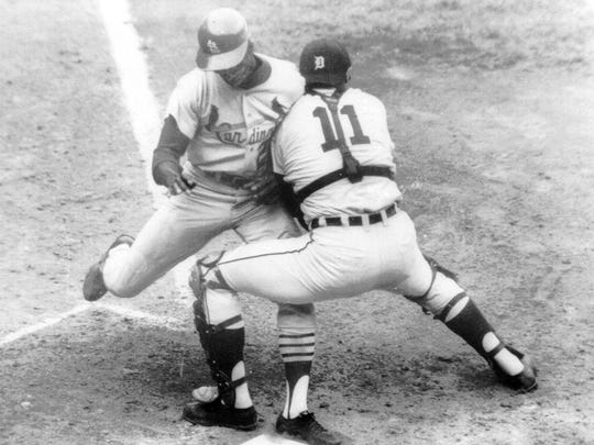 Tigers catcher Bill Freehan puts the tag on Cardinals speedster Lou Brock at home plate in the fifth inning of Game 5 of the World Series at Tiger Stadium, Oct. 7, 1968.
