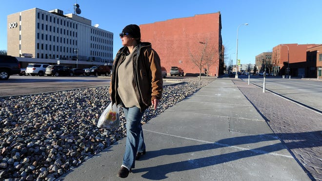 Randall walks the streets of downtown Sioux Falls. Randall says she is homeless.