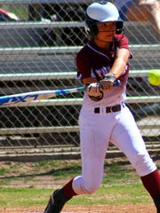 Tularosa freshman Jordan Gaston swings at a pitch.