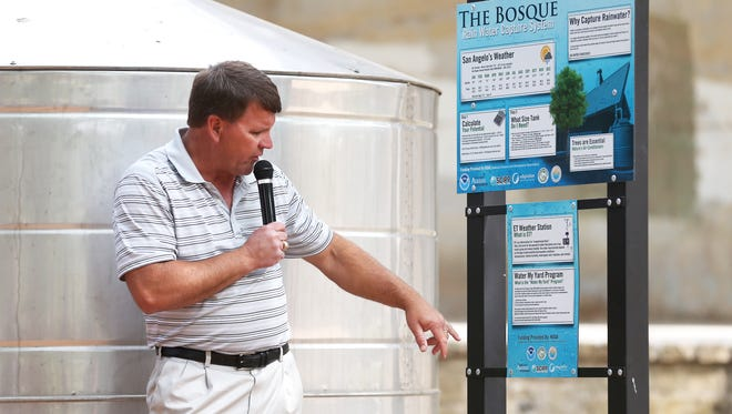 Roger Havlak discusses the Bosque's new rain water collection tank to a group of resident's who attended a water conservation seminar at the Bosque on Saturday, April 29, 2017.