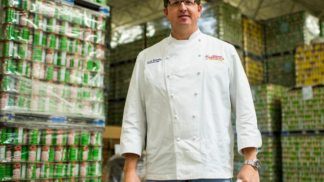 Jude Tauzin, corporate chef for Tony Chachere's Cajun Foods, poses for a photograph in the company's production facility in Opelousas, La., Monday, March 23, 2015.