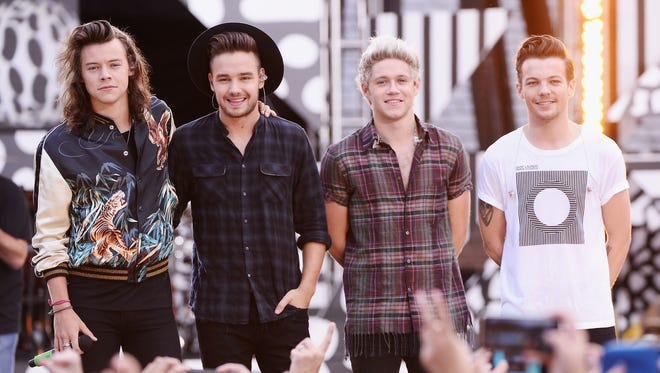 (L-R) Harry Styles, Liam Payne, Niall Horan, and Louis Tomlinson of One Direction perform on ABC's 'Good Morning America' at Rumsey Playfield, Central Park on August 4, 2015 in New York City.