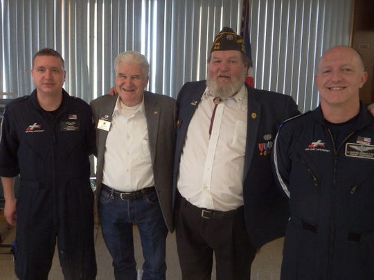 State Representative Jack Fortner and Bull Shoals VFW Commander Chuck Kinler are pictured with members of the Air Evac Life Team.
