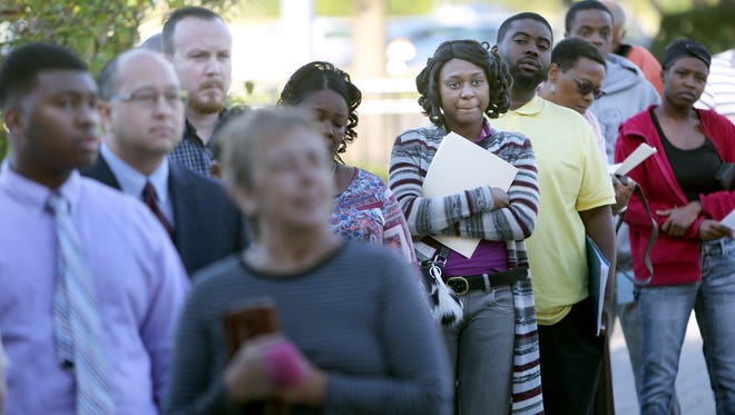 Tamenika Thaddie of Crenshaw, Miss., waits for the doors of the Landers Center in Southaven to open for the Governor's Job Fair. Hundreds of applicants attended the annual event seeking work from an array of employers.