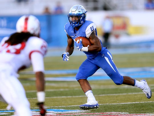MTSU's I'Tavius Mathers (4) runs the ball against WKU