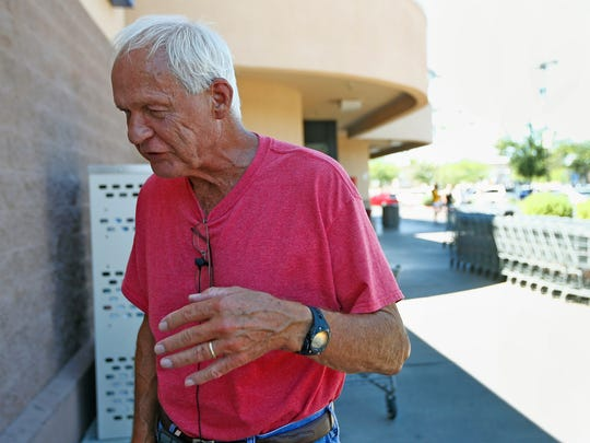 John Libby, 80, of Sun City stands out in front of a grocery store as he talks about his support for President Donald Trump on Aug. 16, 2017, in Sun City.