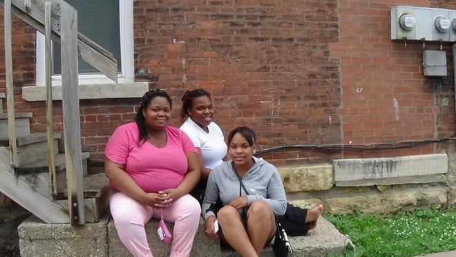 Sandy Vassel, left, Nina Woods and Jadaa Christen in Dubuque, Iowa.