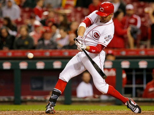 Cincinnati Reds first baseman Joey Votto (19) hits a go-ahead solo home run in the bottom of the seventh inning.