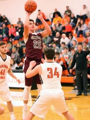 Genoa's Nate Lewis shoots Wednesday in a win over Gibsonburg.