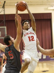 SJCC's Mikey Moore looks to score as Vanlue's Caleb
