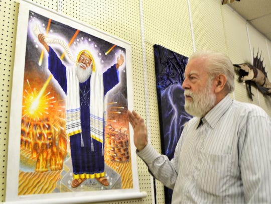 Norbert Kox describes a painting based on an incident described 1 Kings at his Apocalypse House and NEW Museum of Visionary Art, which opened in June in Gillett.
