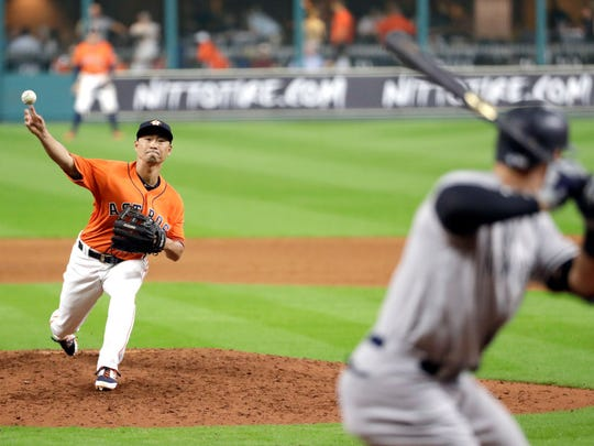 Astros leftfielder Norichika Aoki pitches to Aaron Judge of the Yankees in the ninth inning of a blowout loss on Friday night in Houston. Aoki, who played two seasons with the Brewers, allowed three runs on one hit with two walks in his one inning of work.