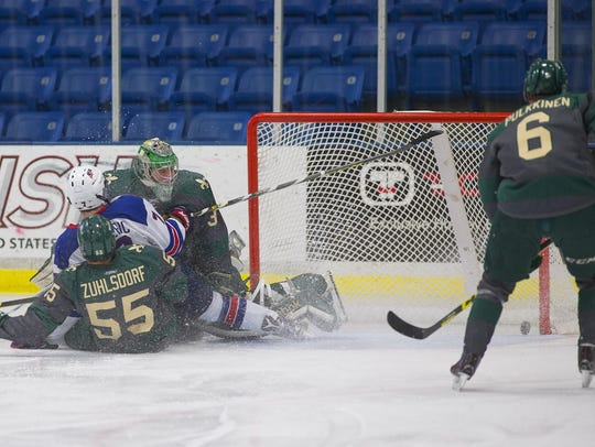 Crashing into the Sioux City goal crease during Saturday's