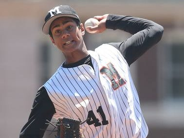 Mamaroneck's Kumar Nambiar pitching against North Rockland in a boys baseball playoff game at Mamaroneck High School May 23, 2015. Mamaroneck won the game 5-3.